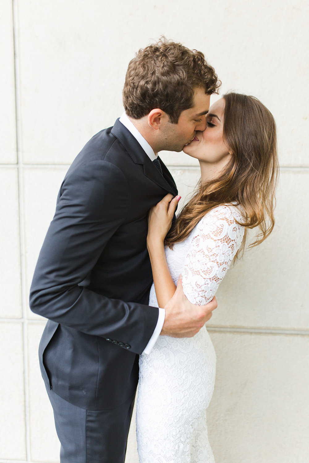 Seattle Courthouse Wedding | Seattle Municipal Court | Downtown Seattle Wedding | Intimate Elopement Wedding | Beautiful Simple Courthouse Wedding | Bride and Groom Portrait | White Wedding Jumpsuit Outfit | Posing Inspiration | Kiss Shot Wedding