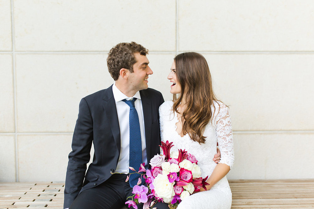 Seattle Courthouse Wedding | Seattle Municipal Court | Downtown Seattle Wedding | Intimate Elopement Wedding | Beautiful Simple Courthouse Wedding | Bride and Groom Portrait | White Wedding Jumpsuit Outfit | Beautiful Purple Wedding Bouquet | Mastin Labs Fuji 400