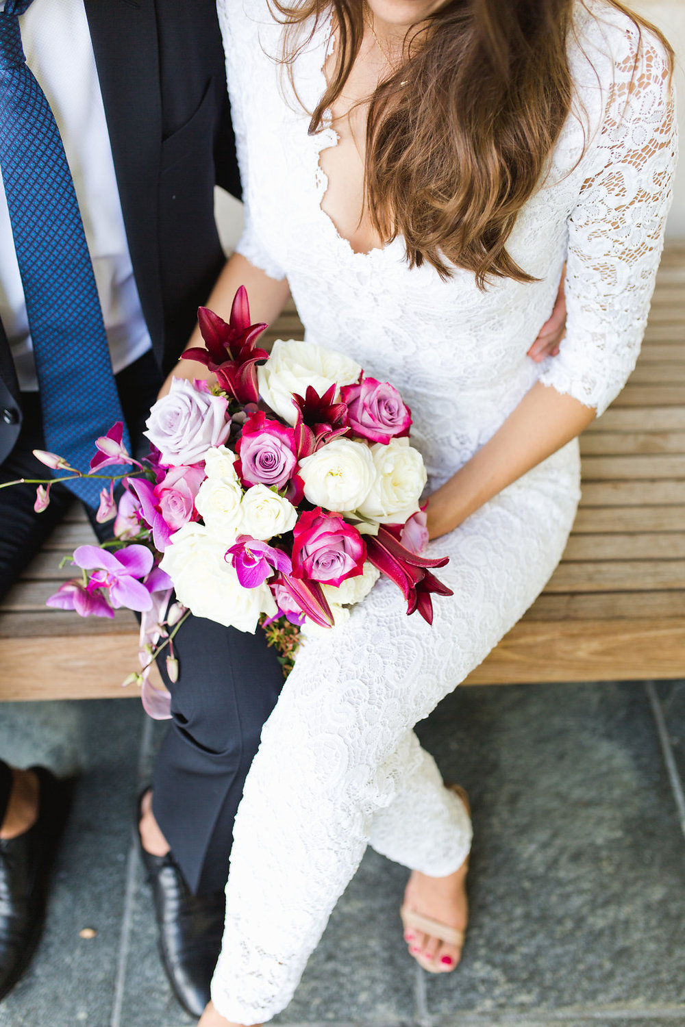 Seattle Courthouse Wedding | Seattle Municipal Court | Downtown Seattle Wedding | Intimate Elopement Wedding | Beautiful Simple Courthouse Wedding | Bride and Groom Portrait | White Wedding Jumpsuit Outfit | Beautiful Purple Wedding Bouquet | Mastin Labs Fuji 400 | Wedding Details