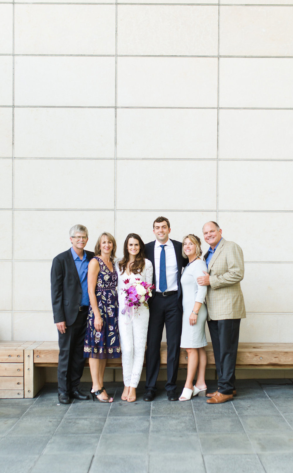 Seattle Courthouse Wedding | Seattle Municipal Court | Downtown Seattle Wedding | Intimate Elopement Wedding | Beautiful Simple Courthouse Wedding | Bride and Groom Portrait | White Wedding Jumpsuit Outfit | Bride and Groom with Parents | Family Formal Wedding Portrait | Mastin Labs Fuji 400