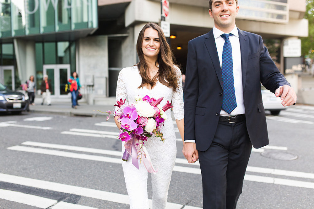 Seattle Courthouse Wedding | Seattle Municipal Court | Downtown Seattle Wedding | Intimate Elopement Wedding | Beautiful Simple Courthouse Wedding | Bride and Groom Portrait | White Wedding Jumpsuit Outfit | Bride and Groom Downtown Seattle Portrait | Mastin Labs Fuji 400 | Beautiful Downtown Wedding | Purple Wedding Bouquet