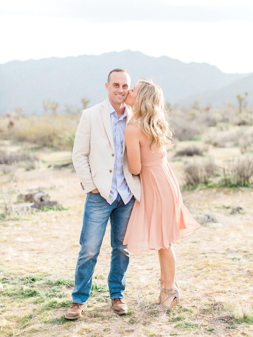 Joshua Tree Engagement Session | What to Wear for Pictures | Southern California Wedding Photographer | Mastin Labs Fuji Film | Fine Art Photographer | Desert Shoot | Kiss on Cheek Shot.jpg