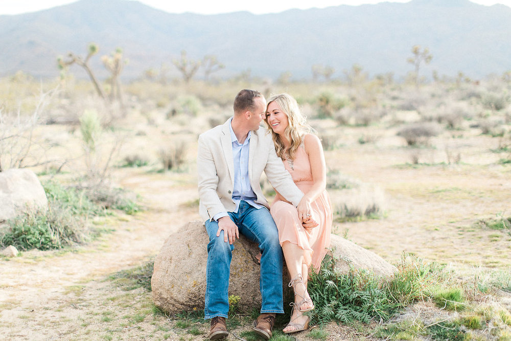 Joshua Tree Engagement Session | What to Wear for Pictures | Southern California Wedding Photographer | Mastin Labs Fuji Film | Fine Art Photographer | Desert Shoot | Sitting on Rock.jpg