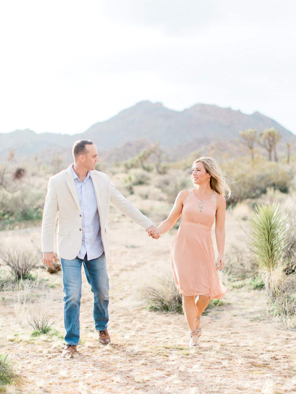 Joshua Tree Engagement Session | What to Wear for Pictures | Southern California Wedding Photographer | Mastin Labs Fuji Film | Fine Art Photographer | Desert Shoot | Walking in the desert.jpg