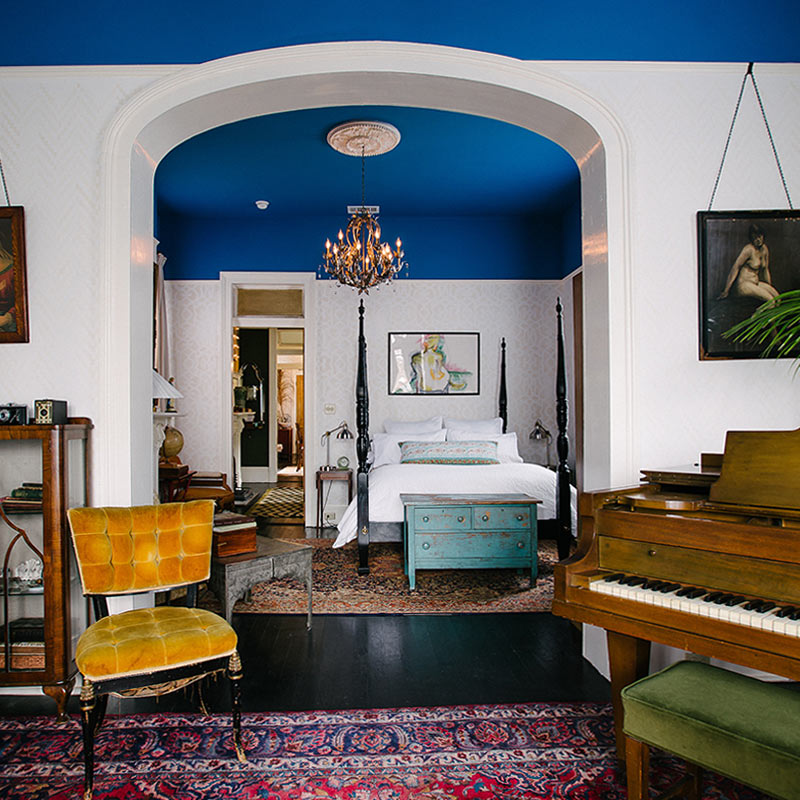 Paining the ceiling in cobalt blue makes this 1800s New Orleans house look contemporary and exciting. via  Design Sponge