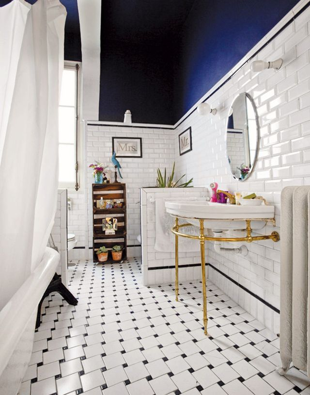 The indigo ceiling in this bathroom added depth and gives the illusion of height. via  My Domaine