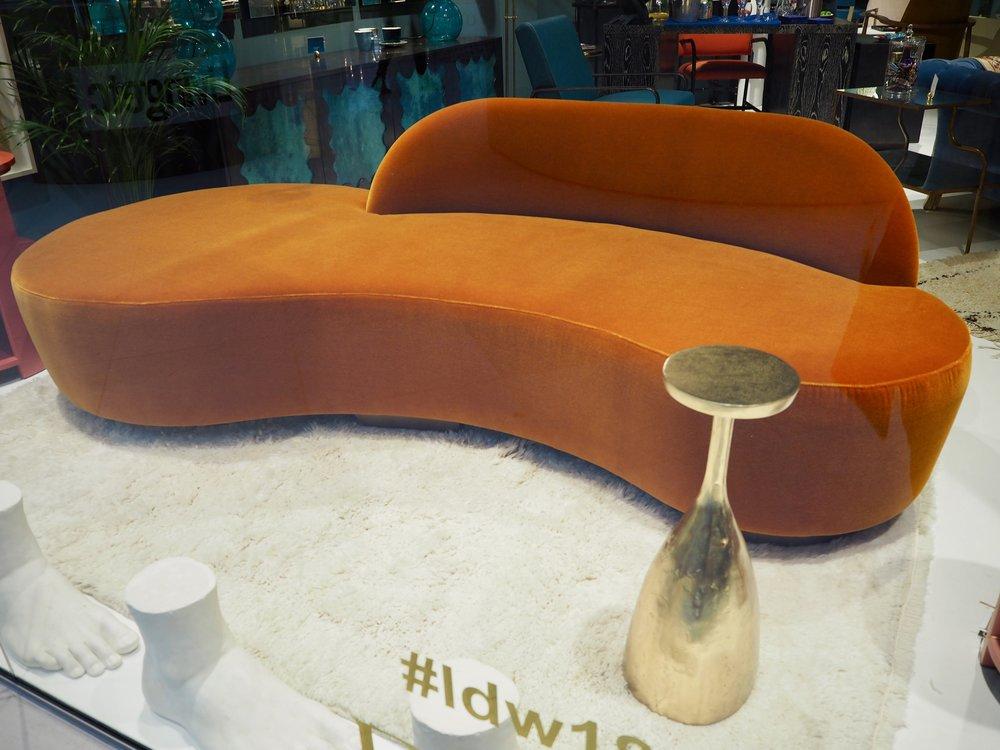 The Parrot Sofa in burnt orange velvet by  Julian Chichester