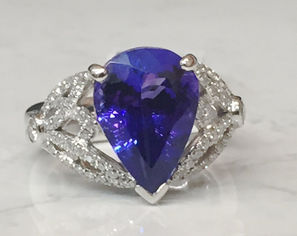 Stunning 5.0 ct Tanzanite with 0.46 ctw diamonds in a 18K white gold mount.  $11,541.20