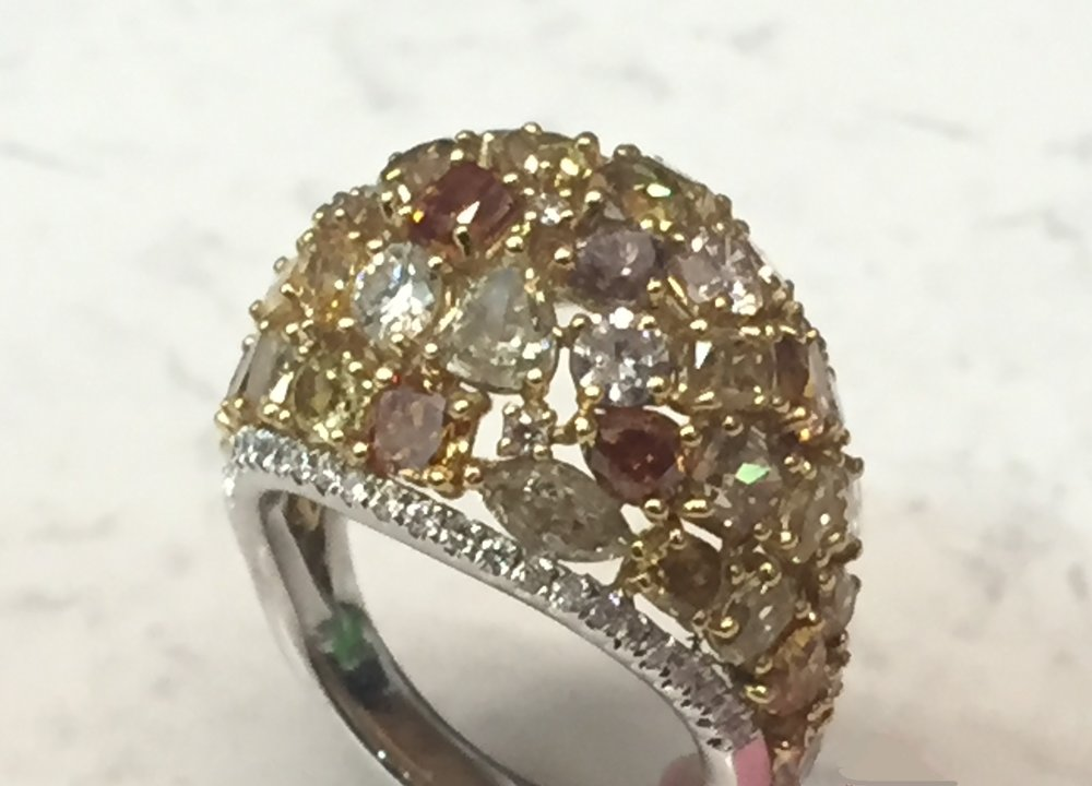 Multi-colored dome ring with 7.26 ctw diamonds, featuring yellow, cognac, and white diamonds; 18K white gold shank.  $23,676.00
