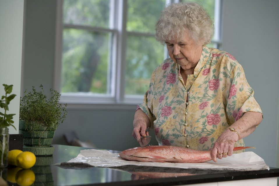 14735-an-elderly-woman-preparing-fresh-fish-pv.jpg