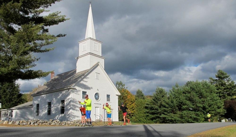My high school teammates skiing by a church.