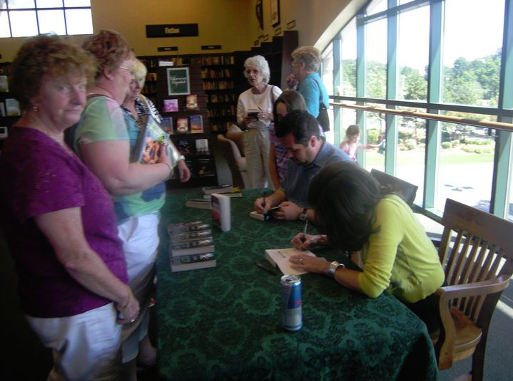 Kevin and Rebecca doing a signing. Contrary to popular opinion, their autographs do  not  decrease the value of the books (drastically).