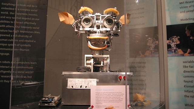Kismet robot  at MIT Museum (cropped), by  Polimerek  - Wikimedia Creative Commons ( license )