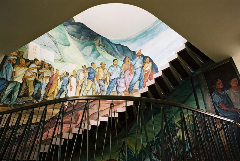 Electric light supplemented the skylight at the top of the stairs where the mural depicts and celebrates the formation of the labor union.