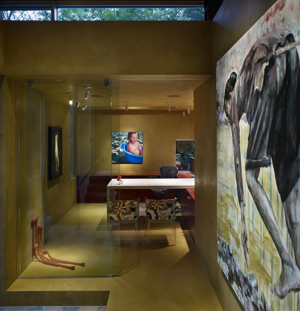 The home office was a contemporary gallery in itself a backdrop of rich Venetian plaster surfaces.