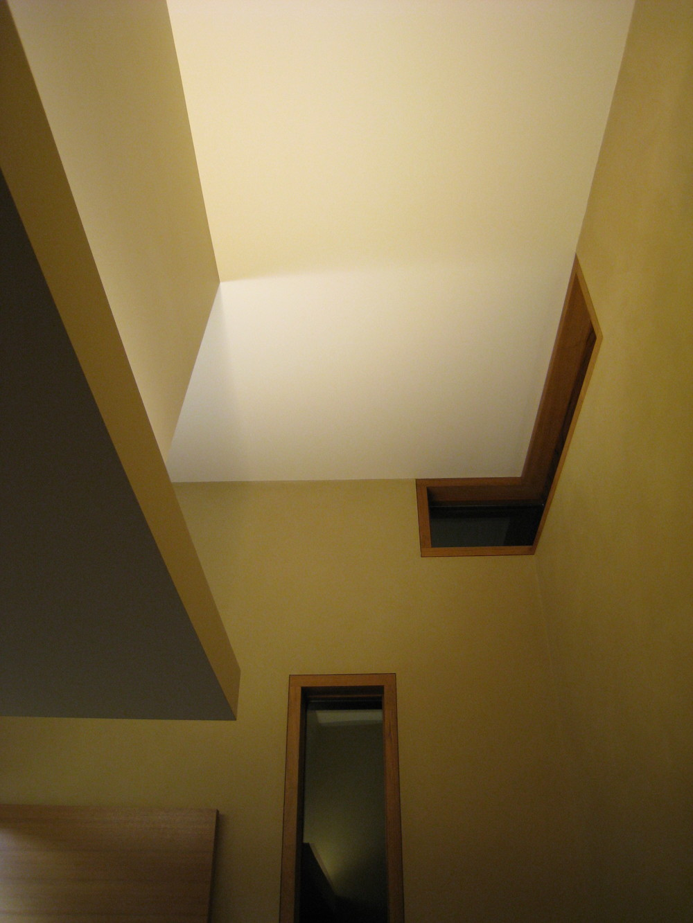 Indirect lighting was designed to accentuate intersecting architectural planes, yet hide the light source. Looking up, it's curious where the walls stop and the ceiling begins.