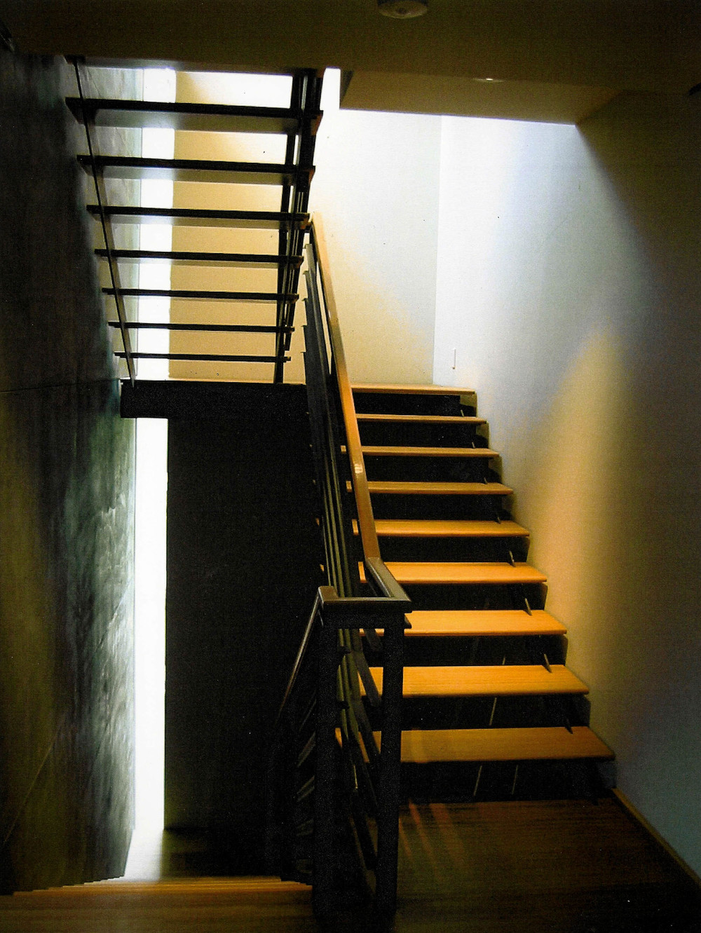 Recessed lighting was designed to light the step platform and to fill the stairwell with light from above.