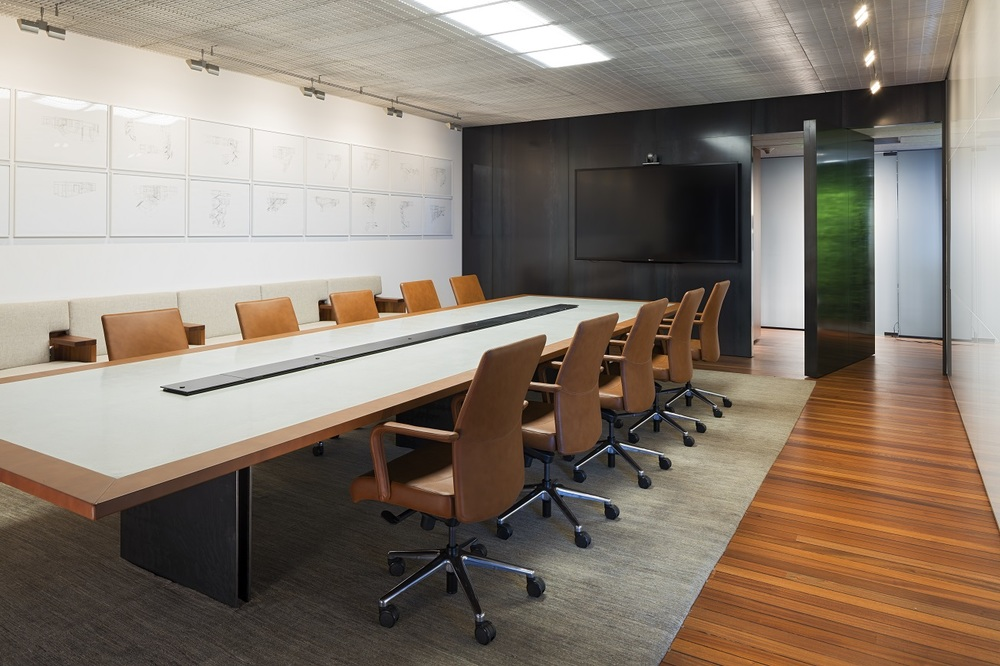 Horizontal and vertical surfaces are assigned to separate circuits for variable scenes and tasks. White boards are evenly lit with LED wallwashers for task lighting. LED flat panels disappear into the shimmery silver ceiling system when turned off.