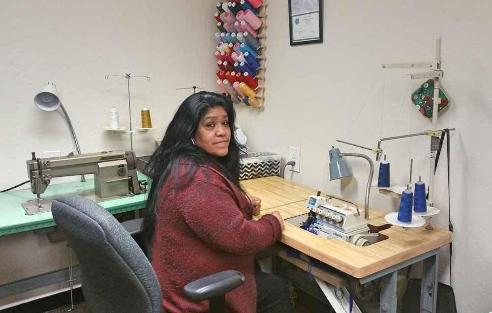 Maria Gutierrez came to Community Enterprise  as a referral from the Small Business Development Center in Everett. After being laid off from a wedding gown alteration job at a national bridal shop, Maria decided to pursue her dream of starting her own sewing and alteration business. With years of experience running her own business in Mexico before migrating to the United States, she knew she could do it, but she lacked the necessary financial resources and equipment. A victim of domestic violence and a single mom, Maria and her daughter are currently receiving housing assistance and food stamps to augment their daily needs. After completing our First Step course, we connected Maria to the Latina Education Training Institute to help improve her English and helped her secure a loan of $1,500 to buy a commercial grade sewing machine and launch Yolanda's Alterations in a subleased storefront space in a busy part of downtown Everett.