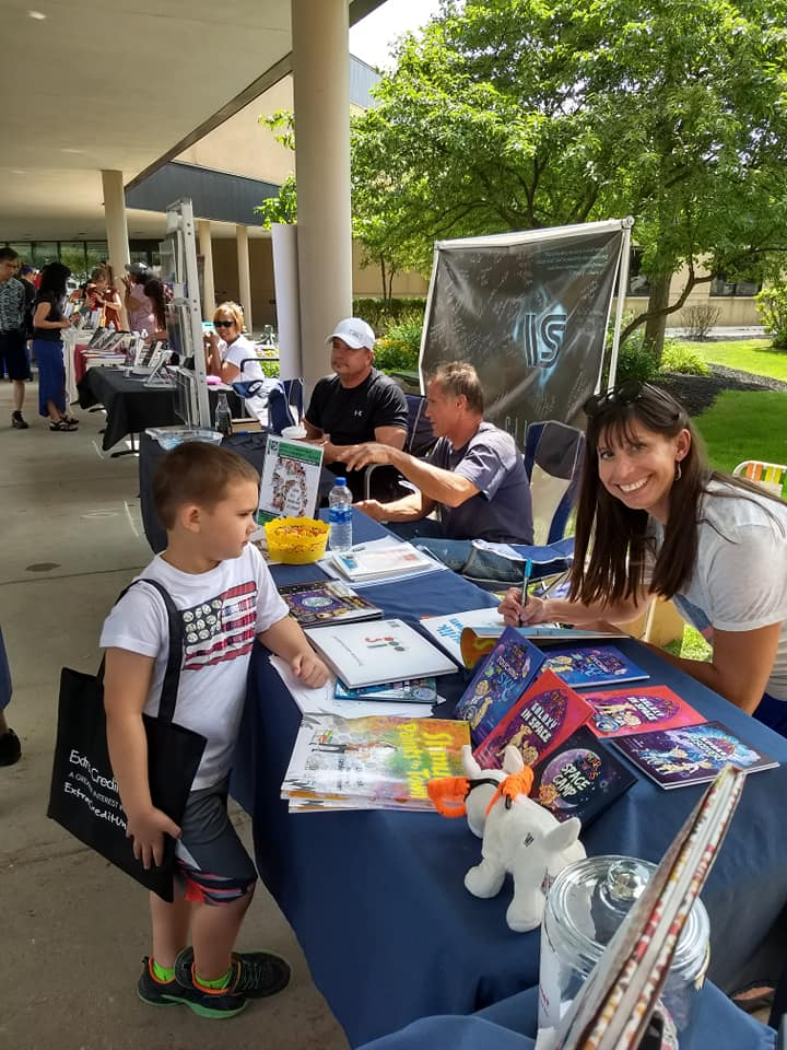 Lisa signing books for a young customer, and a look at the lovely author-lined walkway to the Sterling Heights Library. What a fun, well-organized event!