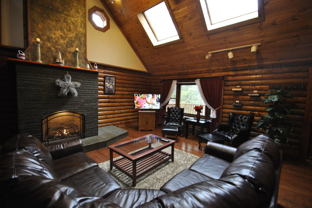 Pennsylvania Mountains, PA - Airbnb / VRBO - Cabin and House Rental with Indoor Swimming Pools in the Poconos: Lodge on Moonlight Drive    Sleeps 16: 7 Bedrooms (6 queen beds and 1 king total), 4 Baths, Beautiful Large Gas Fireplace, Roku w/Sling/Netflix, Large 2nd Floor Master Suite, Firepit in the Back, BBQ Grill, Game Room with Poker Table, Projector, Speakers and a Hot Tub with a beautiful and huge rushing creek.