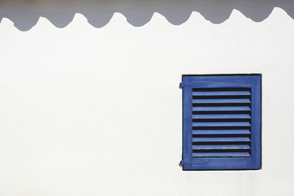 formentera-blue window-window shutters-shadows