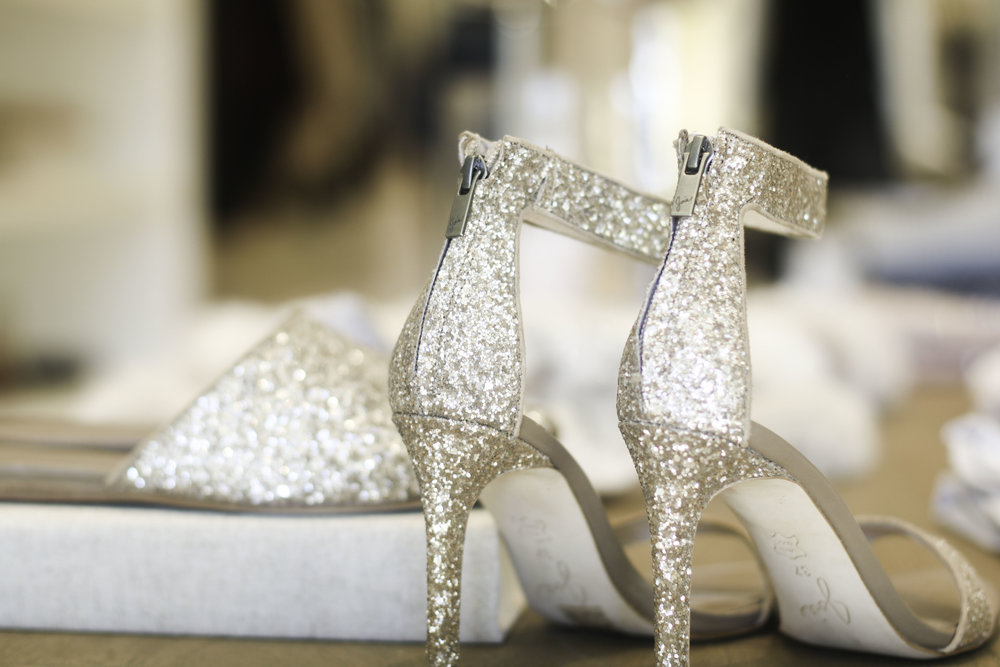 You can never go wrong with a pair of glitter shoes! (  SLIDS  ) (  HEELS  )