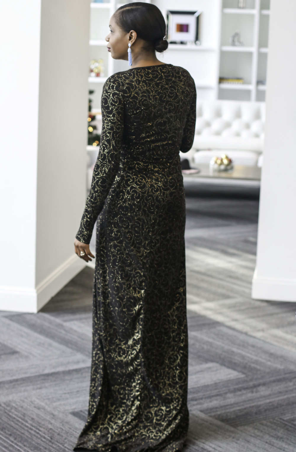 BACK VIEW OF BLACK AND GOLD WRAP DRESS.jpg