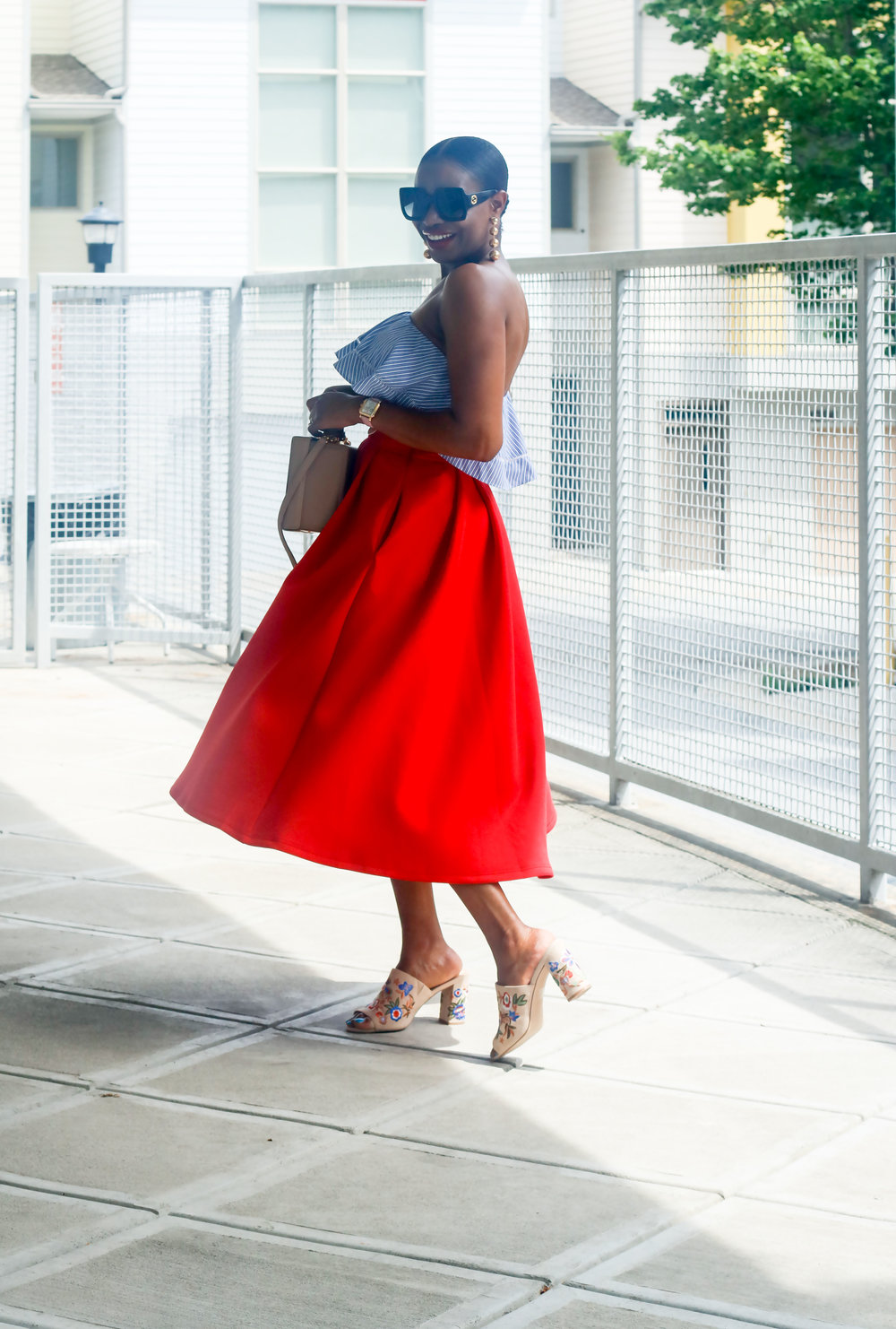 AWED BY MONI WEARING A RED SKIRT.jpg