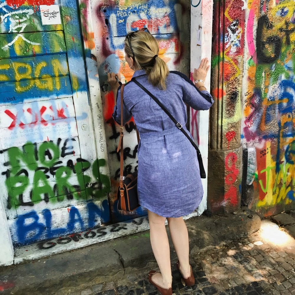 Angie making her mark on the lennon wall