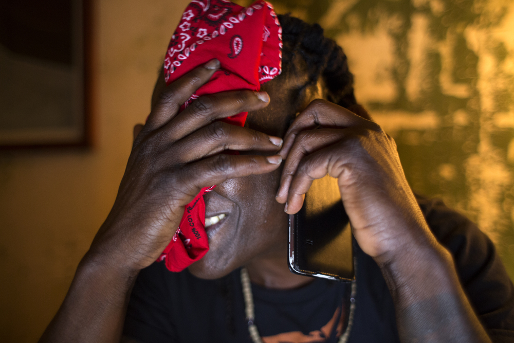 Skyler Cooper  wipes their head from the heat of the day while working on their script of a 60 minute film in the dining room of Jacqui Naylor's house located at 194 Gough Street in San Francisco, Calif. Wednesday April 15, 2015.