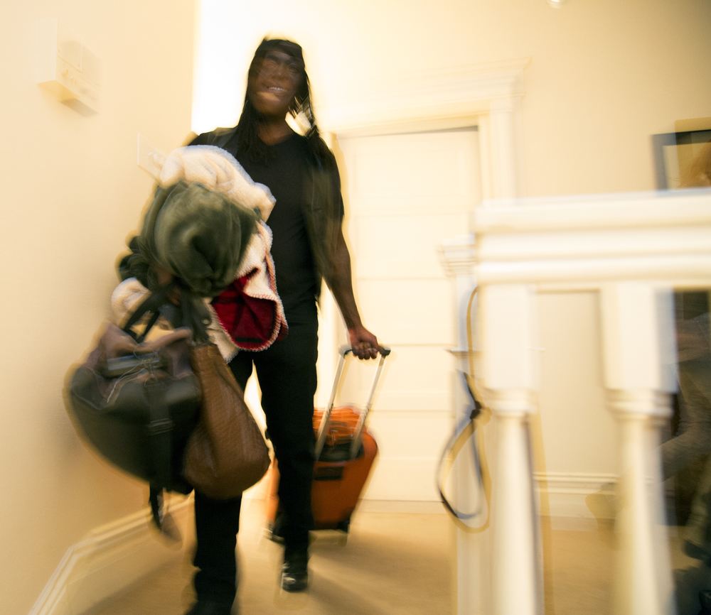 After house sitting for a friend from the Buddhist community Skyler Cooper walks down the stairs on their way to another friend's house Thursday April 9, 2015.