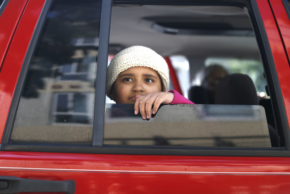 Ava Ramirez looks out the window as she travels back home to Sacramento, Calif, Saturday, March 19, after having lived at Family House on Irving Street for four months, while she received treatment for her bone disease.