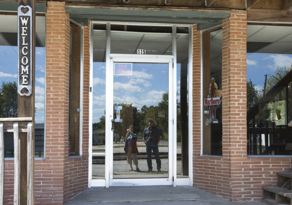 "Normal   0           false   false   false     EN-US   JA   X-NONE                                                                                                                                                                                                                                                                                                                                                                              /* Style Definitions */ table.MsoNormalTable 	{mso-style-name:""Table Normal""; 	mso-tstyle-rowband-size:0; 	mso-tstyle-colband-size:0; 	mso-style-noshow:yes; 	mso-style-priority:99; 	mso-style-parent:""""; 	mso-padding-alt:0in 5.4pt 0in 5.4pt; 	mso-para-margin:0in; 	mso-para-margin-bottom:.0001pt; 	mso-pagination:widow-orphan; 	font-size:12.0pt; 	font-family:Cambria; 	mso-ascii-font-family:Cambria; 	mso-ascii-theme-font:minor-latin; 	mso-hansi-font-family:Cambria; 	mso-hansi-theme-font:minor-latin;}      Lorian Moore and Ron West inspect vacant buildings in downtown Leasburg where only one business, a knife shop operates. Moore and others hope to unite the neighborhood community to care about the future of their town by restoring historical buildings for public and commercial use."