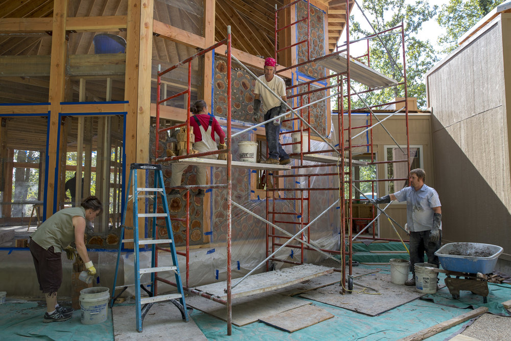 "Normal   0           false   false   false     EN-US   JA   X-NONE                                                                                                                                                                                                                                                                                                                                                                              /* Style Definitions */ table.MsoNormalTable 	{mso-style-name:""Table Normal""; 	mso-tstyle-rowband-size:0; 	mso-tstyle-colband-size:0; 	mso-style-noshow:yes; 	mso-style-priority:99; 	mso-style-parent:""""; 	mso-padding-alt:0in 5.4pt 0in 5.4pt; 	mso-para-margin:0in; 	mso-para-margin-bottom:.0001pt; 	mso-pagination:widow-orphan; 	font-size:12.0pt; 	font-family:Cambria; 	mso-ascii-font-family:Cambria; 	mso-ascii-theme-font:minor-latin; 	mso-hansi-font-family:Cambria; 	mso-hansi-theme-font:minor-latin;}     Lorian Moore cordwoods her friend Tracy Brennan's off–grid house with others in Berger, Missouri. Cordwood construction includes short pieces of debarked tree trunks that are embedded in masonry and cob mixtures to build a wall. She assists and encourages others to build sustainability."