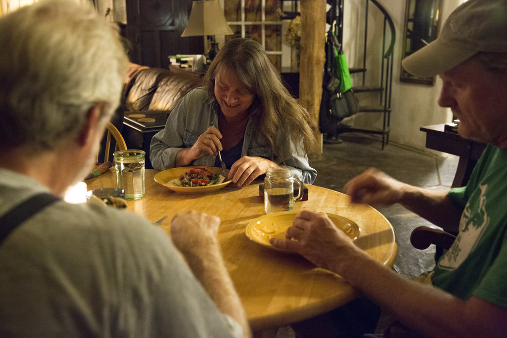 "Normal   0           false   false   false     EN-US   JA   X-NONE                                                                                                                                                                                                                                                                                                                                                                              /* Style Definitions */ table.MsoNormalTable 	{mso-style-name:""Table Normal""; 	mso-tstyle-rowband-size:0; 	mso-tstyle-colband-size:0; 	mso-style-noshow:yes; 	mso-style-priority:99; 	mso-style-parent:""""; 	mso-padding-alt:0in 5.4pt 0in 5.4pt; 	mso-para-margin:0in; 	mso-para-margin-bottom:.0001pt; 	mso-pagination:widow-orphan; 	font-size:12.0pt; 	font-family:Cambria; 	mso-ascii-font-family:Cambria; 	mso-ascii-theme-font:minor-latin; 	mso-hansi-font-family:Cambria; 	mso-hansi-theme-font:minor-latin;}      Lorian Moore eats dinner in her living room with her husband Rex Rohrer (right) and their friend Barry Bookout (left)."