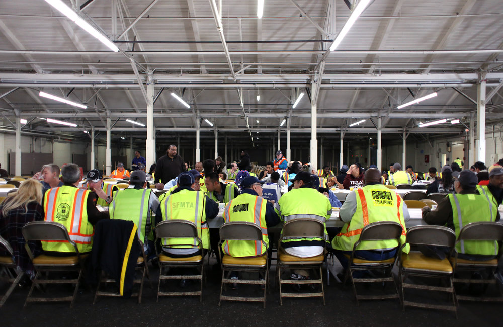 SFMTA bus operators enjoy lunch at San Francisco's 31st bus road-eo where bus operators compete in a series of driving and safety test including an obstacle course showcasing the drivers best skills at Cow Palace Saturday, April 2, 2016. Winners of the competition advance to the American Public Transportation Association International Road-eo. (Emma Chiang/Special to S.F. Examiner)