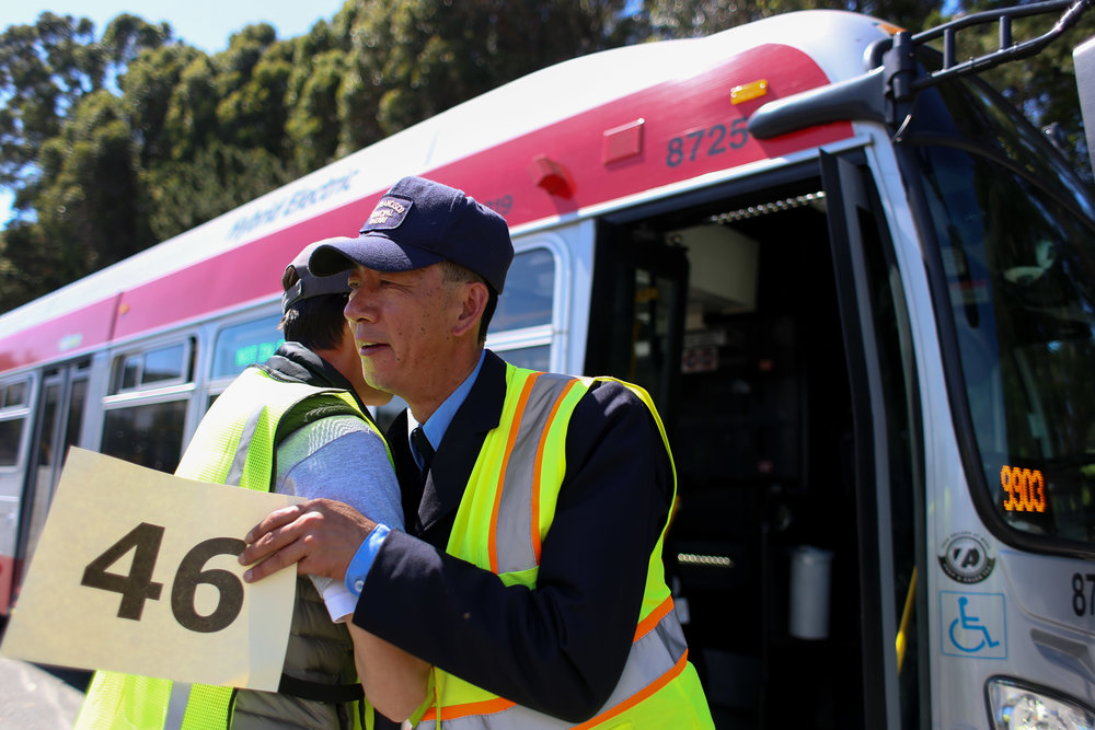 Ce-Qiang Fu SFMTA training inspector is greeted by SFMTA employee after completing his competition at San Francisco's 31st bus road-eo at Cow Palace Saturday, April 2, 2016. (Emma Chiang/Special to S.F. Examiner)