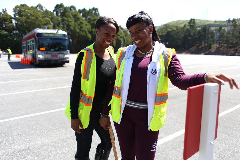 Aleta Washington, left, and Doniki Dudley SFMTA training inspectors pose for a portrait at San Francisco's 31st bus road-eo where bus operators compete in a series of driving and safety test including an obstacle course showcasing the drivers best skills at Cow Palace Saturday, April 2, 2016. Winners of the competition advance to the American Public Transportation Association International Road-eo. (Emma Chiang/Special to S.F. Examiner)