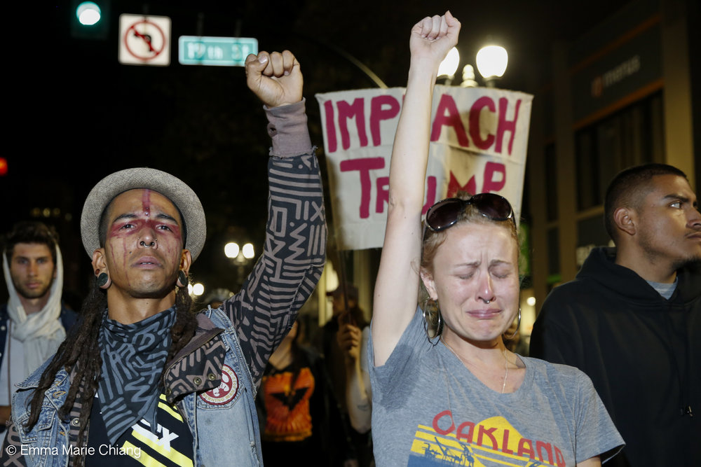 Tigre Bailando (left) and Michaela (right) cry during an anti-Trump protest through the streets of downtown Oakland Wednesday Nov. 9 2016. Photo by Emma Chiang