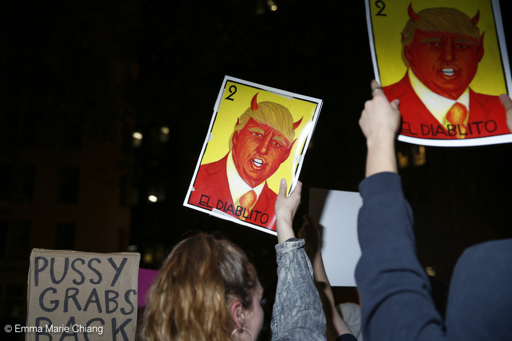 "Hundreds of anti-Trump protesters march through the streets of downtown Oakland yelling ""Not my president"" and ""F*k Trump"" Wednesday Nov. 9 2016. Photo by Emma Chiang"