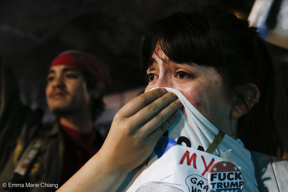 Jaqueline Castillo covers her nose after the Oakland Police Department fired tear gase during an anti-Trump protest through the streets of downtown OaklandWednesday Nov. 9 2016. Photo by Emma Chiang