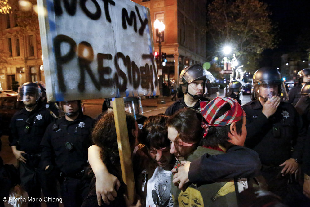 A group of anti-Trump protesters hug each other on Washington Street Oakland, Calif. Wednesday Nov. 9 2016. Photo by Emma Chiang