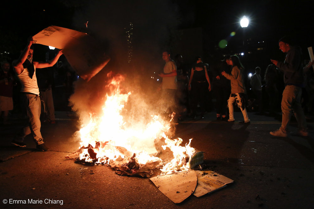 Anti-Trump protesters lite fires on Washington Street in Oakland Calif. Wednesday Nov. 9 2016. Photo by Emma Chiang