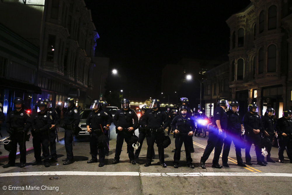 Oakland police officers block Washington Street during an anti-Trump protesters Wednesday Nov. 9 2016. Photo by Emma Chiang