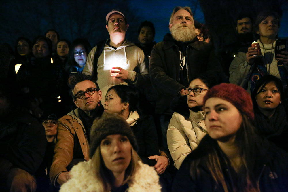 Mourners gather at a vigil for the victims of the fatal warehouse fire during a vigil at Lake Merritt Pergola in Oakland, California, U.S. December 5, 2016.