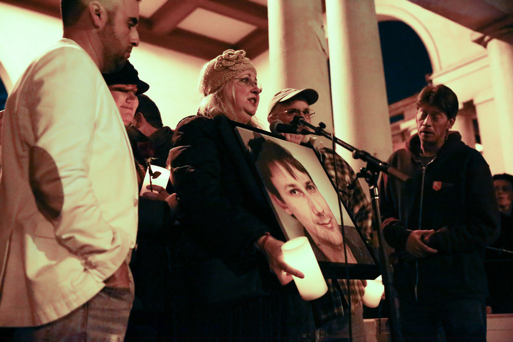 A family shares stories of their son who was one of the 36 people who died in the Oakland Fire during a vigil at Lake Merritt Pergola in Oakland, California, U.S. December 5, 2016.