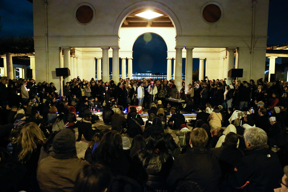 Mourners gather at a vigil for the victims of the fatal warehouse fire during a vigil at at Lake Merritt Pergola in Oakland, California, U.S. December 5, 2016.