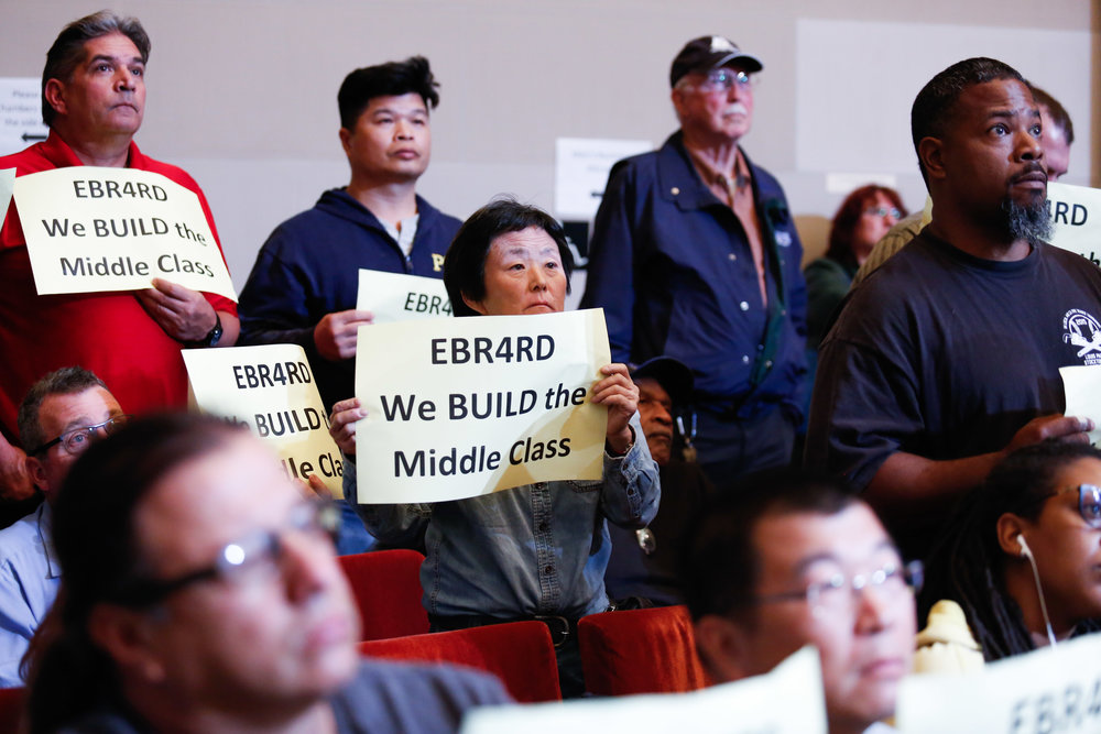 Union members from the East Bay Residents for Responsible Development (EBRRD), which includes UA Local 104, 342, 483, 595 and others rally during the Oakland Planning Commission meeting Tuesday, October 18, 2016. The planning commission postponed the vote until November 2.