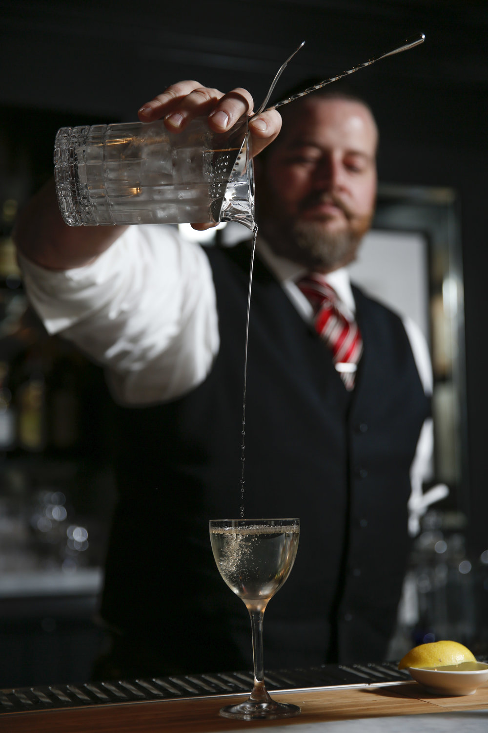 Brandon Clements bartender with Saratoga, an American restaurant with a full bar, makes a drink. The restaurant opens next week located at 1000 Larkin Street in San Francisco, Calif. on Thursday, November 3, 2016.